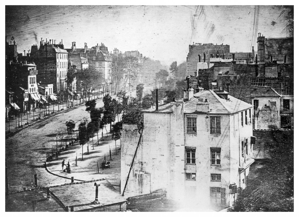 """Boulevard du Temple,"" taken by Daguerre in late 1838 or early 1839 in Paris, was the first photograph of a person."